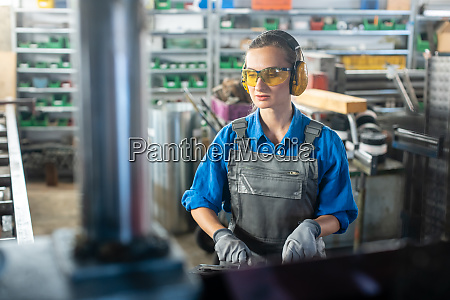 woman worker operating a machine tool