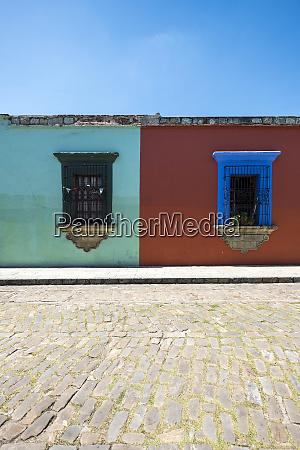 colourful houses with decorative windows oaxaca