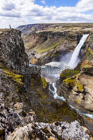 a female hiker poses on the
