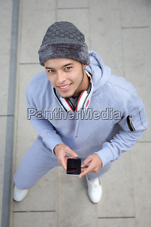 smiling young latin man runner portrait