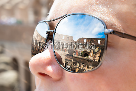colosseum in rome seen in sunglasses