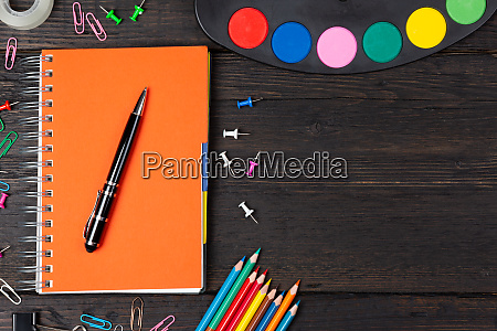 school stationery supplies and watercolors on