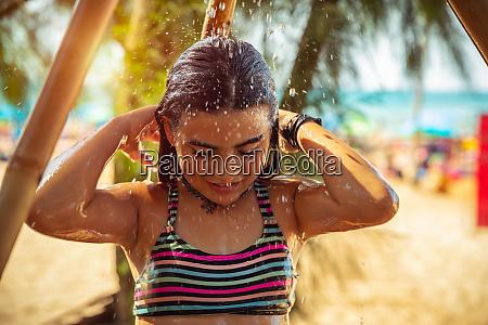 little girl taking shower on the