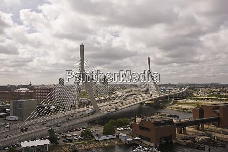 suspension bridge in a city leonard
