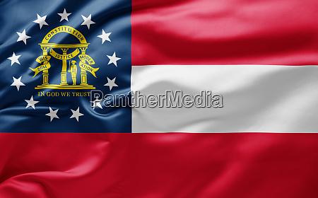 schwenken der staatsflagge von georgia