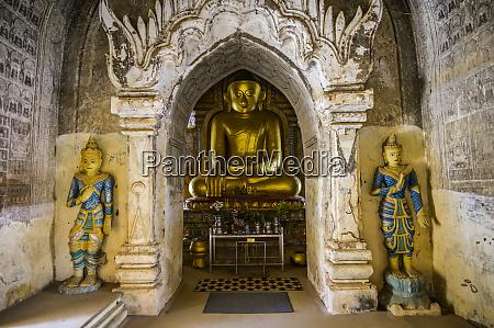 golden buddha statue inside a buddhist