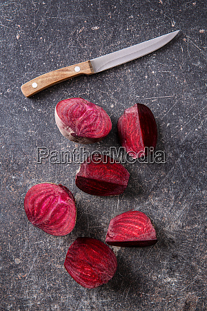 sliced tasty raw beetroot and knife