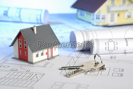blueprints with house keys and houses