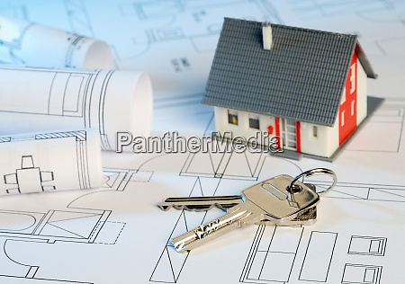 house with blueprints and key