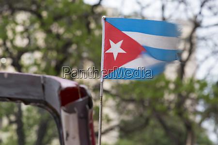 cuba havana tattered cuban flag blowing
