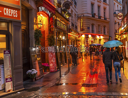 wine bars restaurants colorful rainy streets