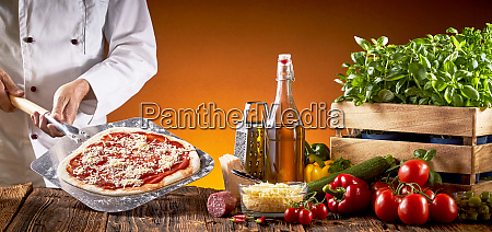 chef making a traditional italian pizza