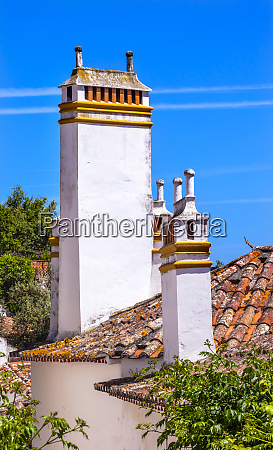 towers chimneys orange roofs medieval town