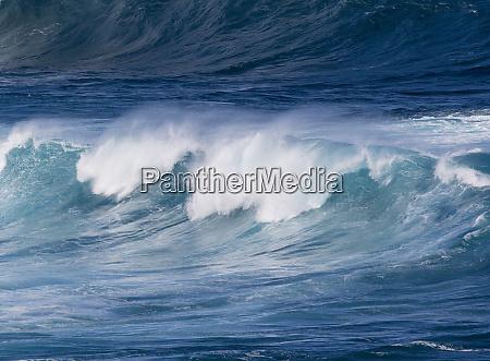 waves cresting along hookipa beach state