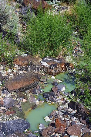 colorful rocks chalky blue green pool