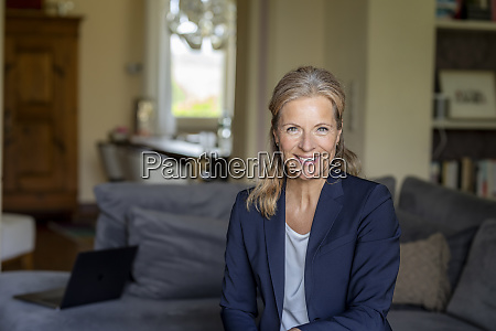portrait of smiling mature businesswoman at