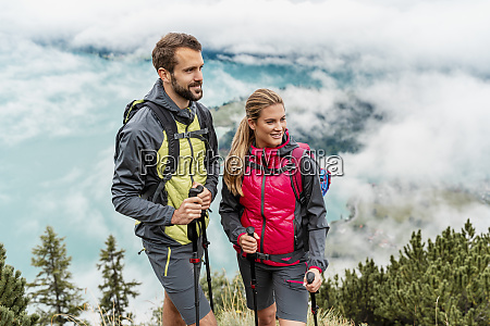 confident young couple on a hiking
