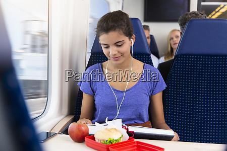 teenage girl traveling alone by train
