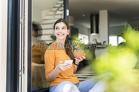 smiling young woman sitting with healthy