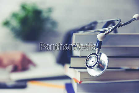 medical college student with stack of