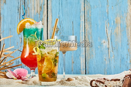 trio of colorful alcoholic cocktails on