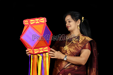 indian woman with lantern