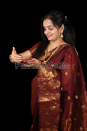 indian woman with diwali lamp