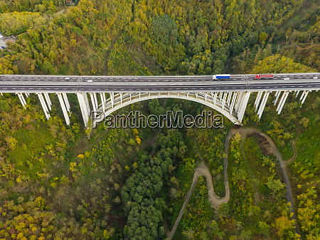 aerial view of arch bridge crossing