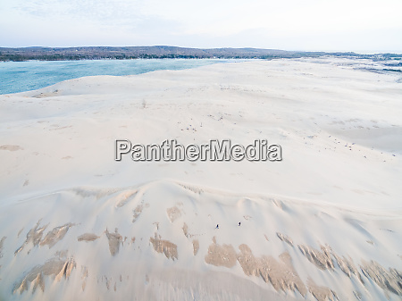 aerial view oftwo persons walking at