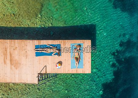 aerial view of two women sunbathing