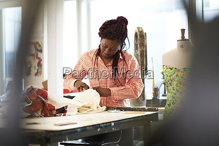 female fashion designer with fabric in