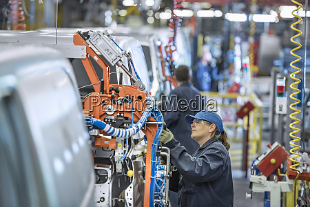 female worker on vehicle production line