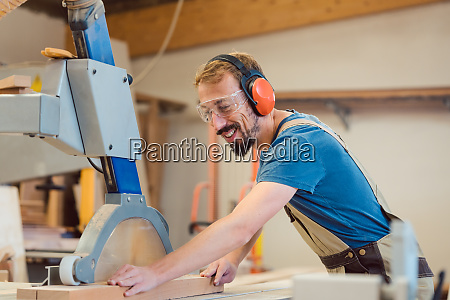 diligent carpenter with fun at work