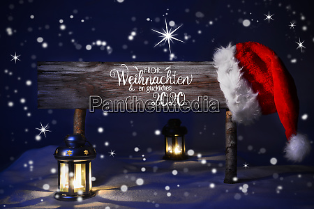 weihnachtsnacht mit schnee lampe santa hut