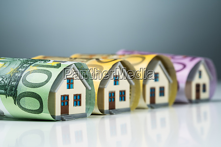 miniature houses inside the euro banknotes
