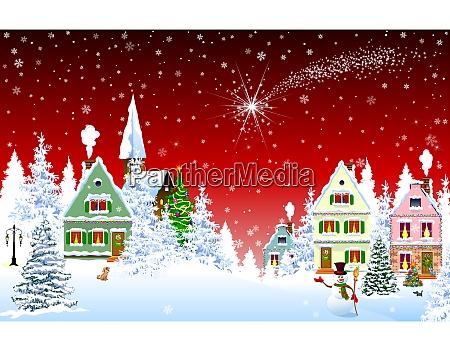 weihnachtsstern am himmel ueber haeusern auf