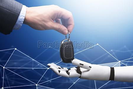 hand geben autoschluessel zum roboter