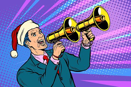 weihnachtsverkauf geschaeftsmann wirbt mit megafon