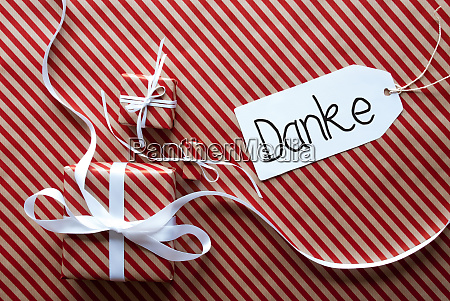drei geschenke packpapier label danke bedeutet