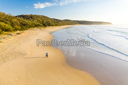 aerial view of couple walking at