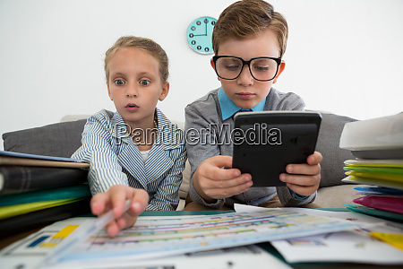 businessman using digital tablet while female