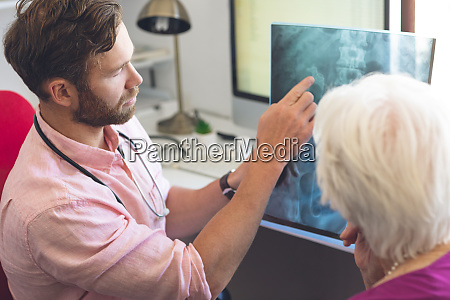 male doctor and senior female patient
