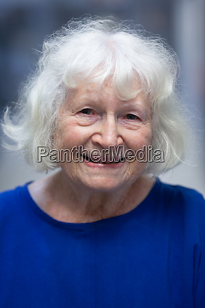 senior female patient smiling while standing
