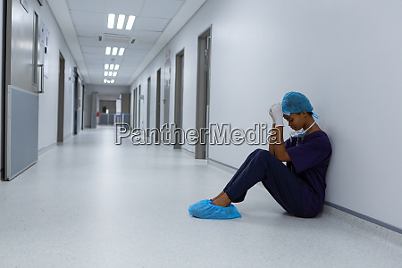 tensed female surgeon with hands on