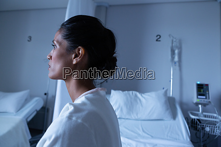 female patient looking away while sitting