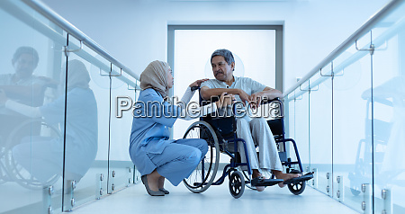 female doctor interacting with disabled male