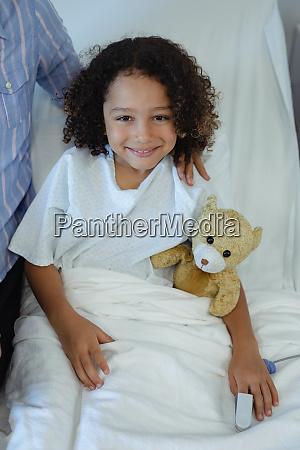 boy patient sitting on bed in