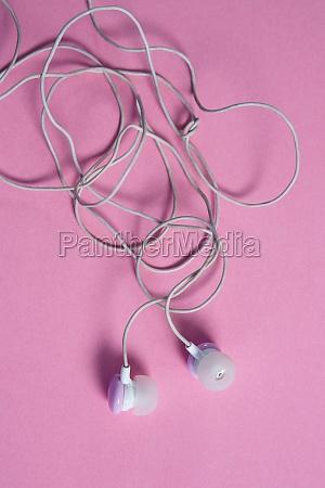 pink earphones on pink background