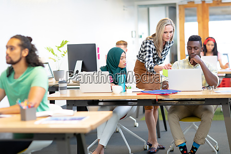 business people discussing over laptop at