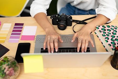 female graphic designer using laptop at